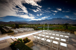 Outdoors wedding with mountain in the background